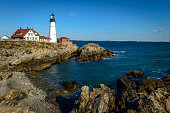 Historic Portland Head Light lighthouse in Cape Elizabeth, Maine. The lighthouse sits at the entrance of the primary shipping channel into Portland Harbor, which is within Casco Bay in the Gulf of Mai