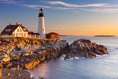 The Portland Head Lighthouse in Maine, USA at sunrise.