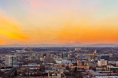 Portland Oregon downtown cityscape with Mt Saint Helens view during sunset at dusk United States America