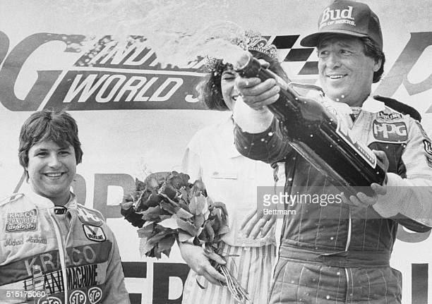 Claudia Reimer ducks as Mario Andretti sprays the crowd around the victory stand 6/15 with beer Mario won the Portland Rose Festival Cart 200 race by...