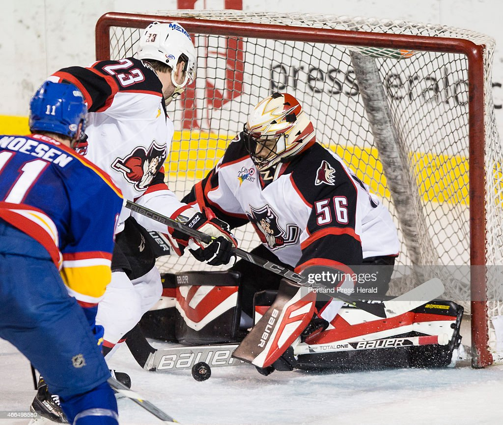 Portland Pirates goalie Mike McKenna makes a save against the Norfolk Admirals during AHL action at Cross Insurance Arena