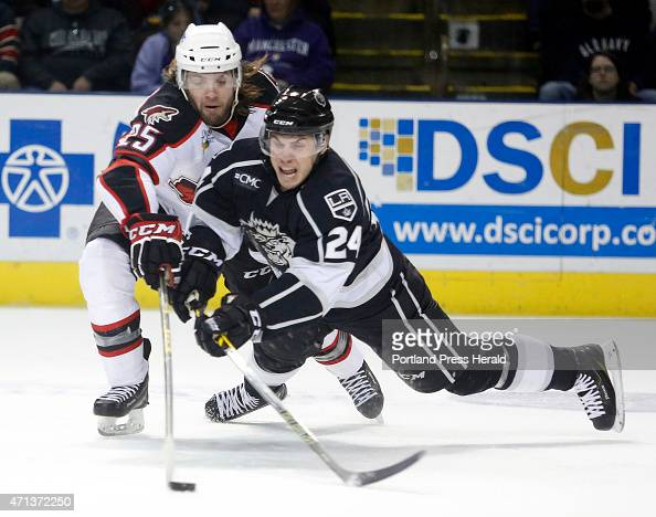 Portland Pirates vs Manchester Monarchs Eric Selleck of Portland reaches to knock the puck away from Ryan Horvat of Manchester during the second...
