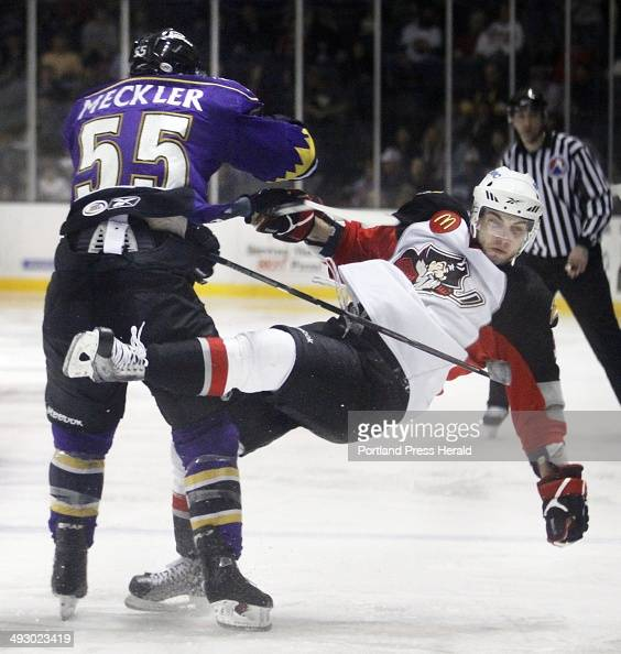 Portland Pirates vs Manchester Monarchs TJ Brennan right of Portland takes a hit from Manchester's David Meckler during the second period...
