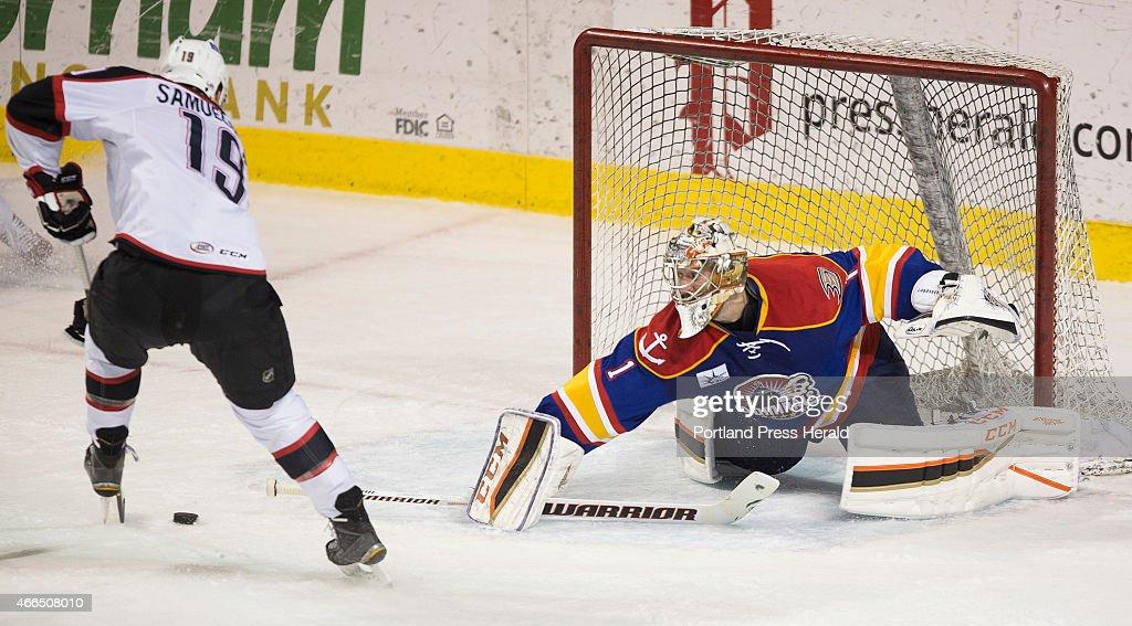 Portland Pirateswing Henrik Samuelsson makes a move before scoring a goal against Norfolk Admirals goalie Jason LaBarbera during AHL action at Cross...