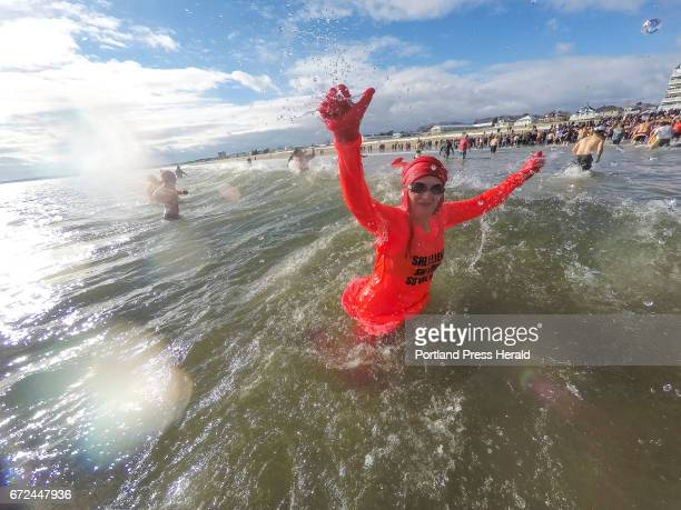 Portland resident Mary Baumer emerges from 47degree water Friday during the 28th annual Lobster Dip at Old Orchard Beach benefitting Special Olympics...
