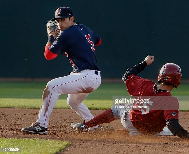 Portland Sea Dogs host Altoona Carlos Asuaje of Portland looks toward first but holds the throw after forcing out Max Moroff of Altoona during the...