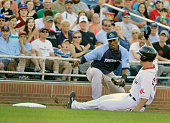 Portland Sea Dogs vs Trenton Thunder at Hadlock Field Portland's Nate Freiman slides into third base ahead of a tag attempt by Trenton third baseman...