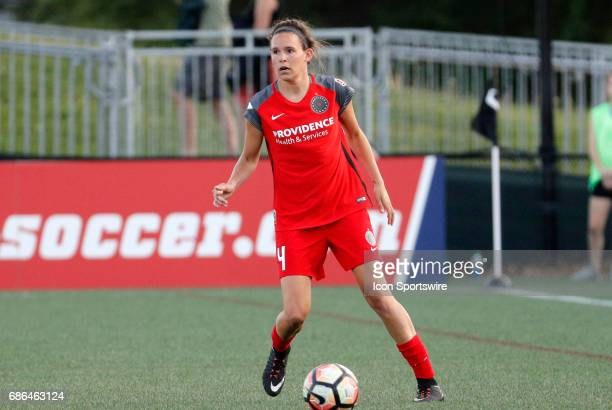 Portland Thorns FC defender Emily Menges holds the ball up during an NWSL regular season match between the Boston Breakers and Portland Thorns FC on...