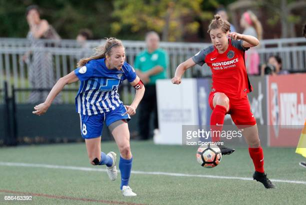 Portland Thorns FC defender Meghan Klingenberg controls the ball watched by Boston Breakers defender Julie King during an NWSL regular season match...