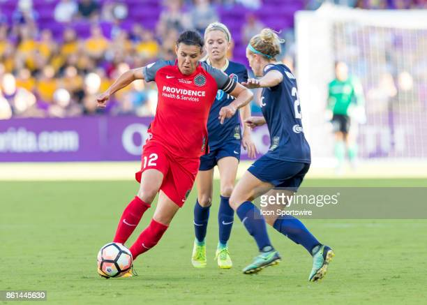 Portland Thorns FC forward Christine Sinclair dribbles through North Carolina Courage players during the NWSL soccer Championship match between the...