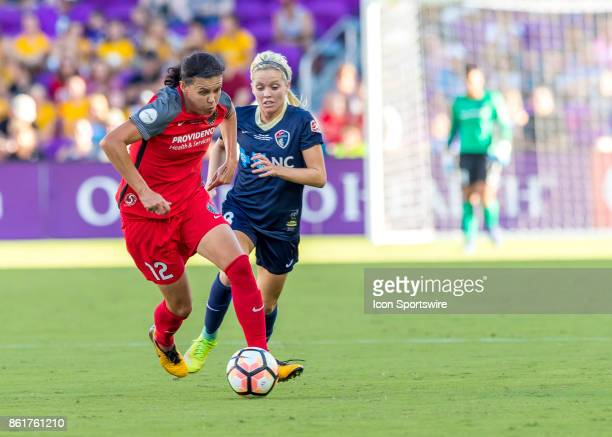 Portland Thorns FC forward Christine Sinclair drives the ball up field during the NWSL soccer Championship match between the North Carolina Courage...