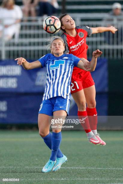 Portland Thorns FC forward Hayley Raso and Boston Breakers midfielder Rosie White vie for the header during an NWSL regular season match between the...