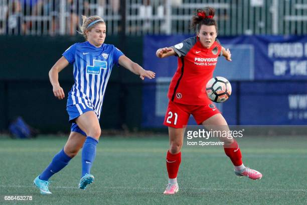 Portland Thorns FC forward Hayley Raso tries to control the ball as Boston Breakers midfielder Rosie White moves in during an NWSL regular season...