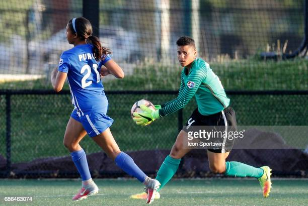 Portland Thorns FC goalkeeper Adrianna Franch beats Boston Breakers forward Midge Purce to the ball during an NWSL regular season match between the...