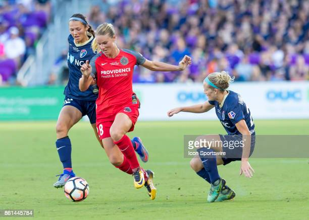 Portland Thorns FC midfielder Amandine Henry splits two North Carolina Courage players during the NWSL soccer Championship match between the North...