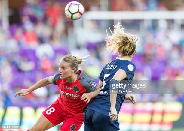 Portland Thorns FC midfielder Amandine Henry vs North Carolina Courage midfielder Samantha Mewis challenge for a header during the NWSL soccer...
