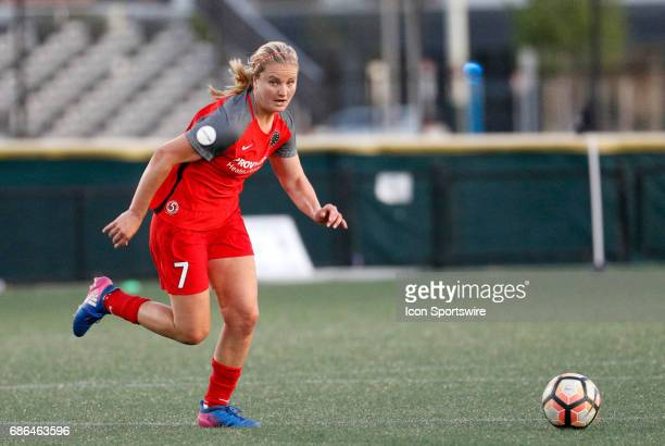Portland Thorns FC midfielder Lindsey Horan looks for the pass as she chases down the ball during an NWSL regular season match between the Boston...