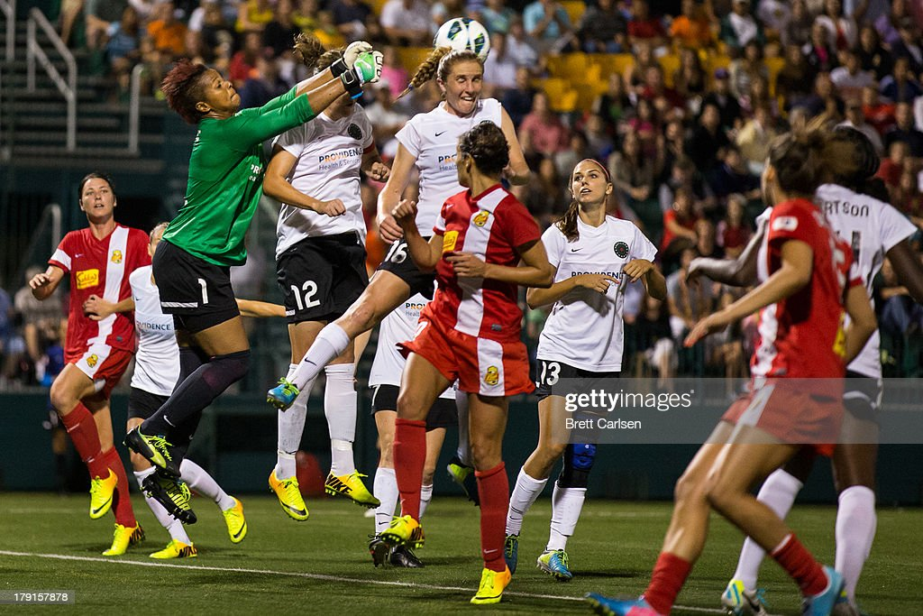 Portland Thorns goalkeeper <a gi-track='captionPersonalityLinkClicked' href=/galleries/search?phrase=Karina+LeBlanc&family=editorial&specificpeople=2473661 ng-click='$event.stopPropagation()'>Karina LeBlanc</a> #1 punches a Western New York Flash corner kick out of the penalty box over her teammates' heads in the National Women's Soccer League Championship at Sahlen's Stadium August 31, 2013 in Rochester, New York.