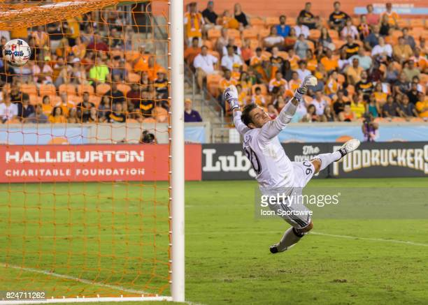 Portland Timbers goalkeeper Jake Gleeson fails to stop a shot on goal during the MLS match between the Portland Timbers and Houston Dynamo on July 29...
