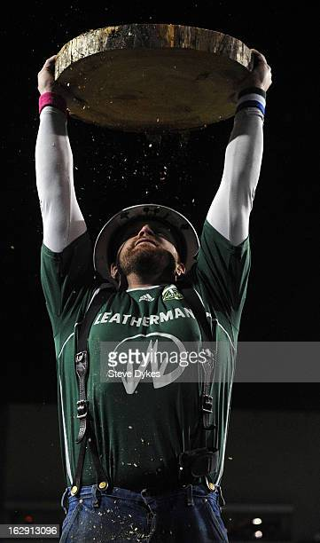 Portland Timbers mascot 'Timber Joey' holds up a timber slab after the team scored a goal during the second half of the game against AIK at JeldWen...