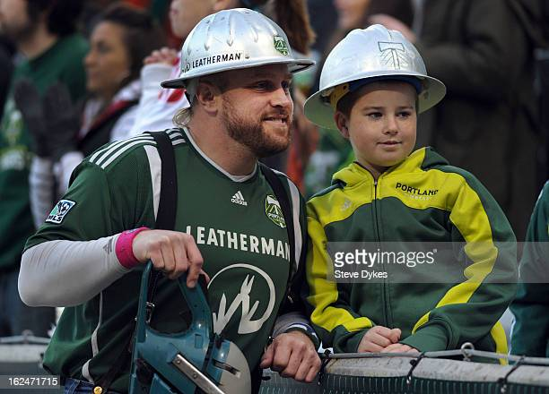 Portland Timbers mascot 'Timber Joey' poses with a fan during the first half of the game between the Portland Timbers and AIK at JeldWen Field on...