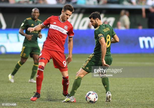 Portland Timbers MF Diego Valeri controls the ball while defended by Chicago Fire F Luis Solignac during a Major League Soccer match between the...