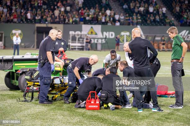 Portland Timbers midfielder Dairon Asprilla is tended by the medics after the end of the Portland Timbers 21 victory over the Colorado Rapids on...