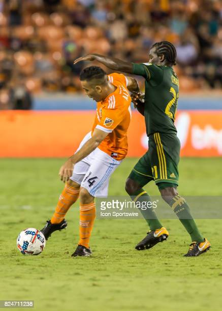 Portland Timbers midfielder Diego Chara challenges Houston Dynamo midfielder Alex for ball during the MLS match between the Portland Timbers and...
