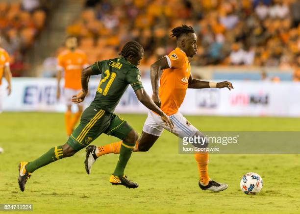 Portland Timbers midfielder Diego Chara chases after Houston Dynamo forward Alberth Elis for the ball during the MLS match between the Portland...
