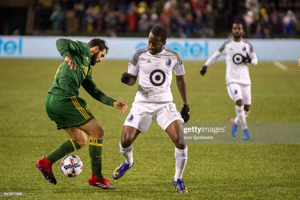 Portland Timbers midfielder Diego Valeri steals from Minnesota United forward Kevin Molino during the first half of Portland Timbers-Minnesota United at Providence Park on March 03, 2017, in Portland, OR. (Photo by Diego Diaz/Icon Sportswire via Getty Images).