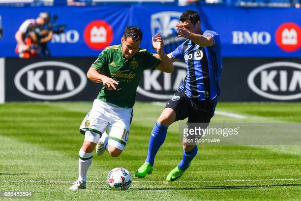 Portland Timbers midfielder Sebastian Blanco battling with midfielder Belrim Dzemaili for control of the ball during the Portland Timbers versus the...