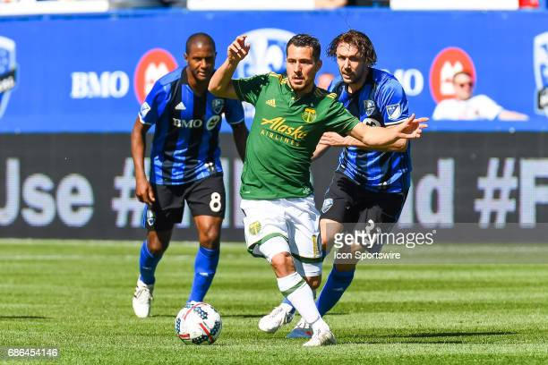 Portland Timbers midfielder Sebastian Blanco trying to stay up in control of the ball while chased by Montreal Impact midfielder Marco Donadel during...