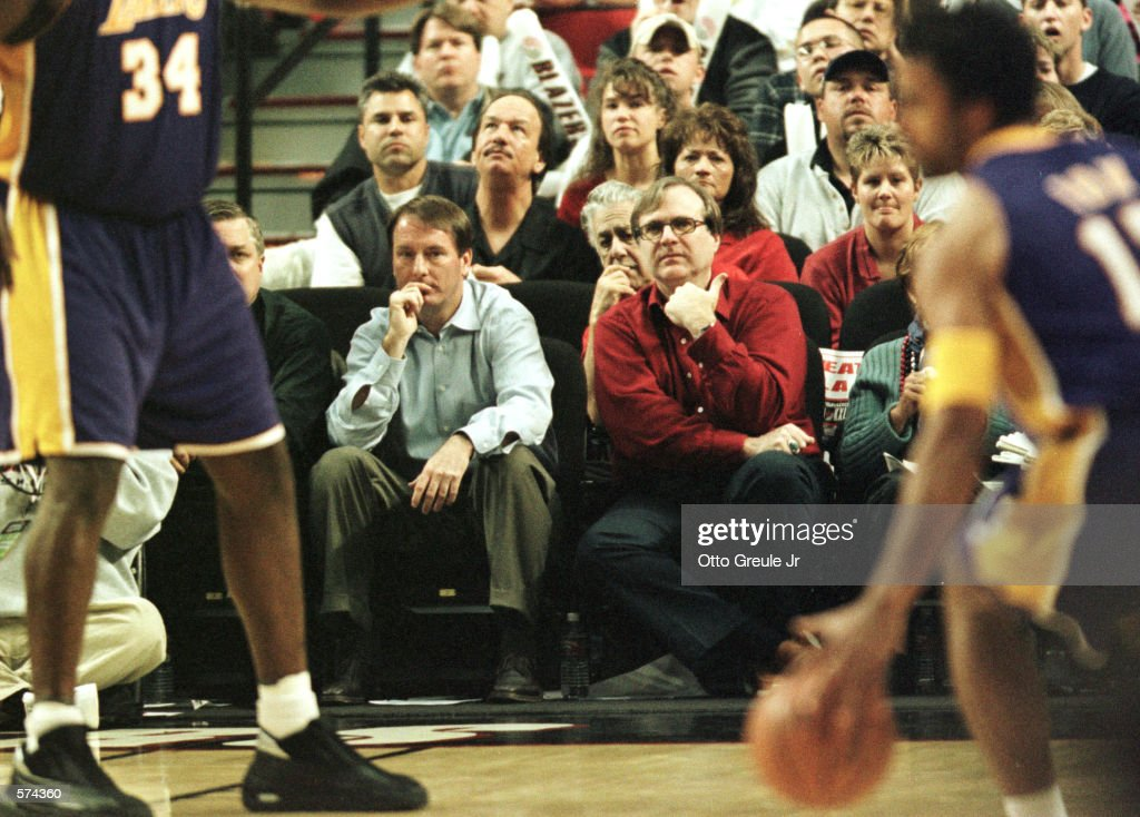 Portland Trail Blazer team owner Paul Allen (right, red shirt) watches from his courtside seat along with team president and general manager Bob Whitsitt (left) during second half action in game 3 of the first round Western Conference Playoffs at the Rose Garden in Portland Oregon. The Lakers defeated the Blazers 99-86 to take the series three games to none. Mandatory Credit: Otto Greule/ALLSPORT.