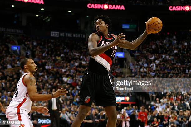Portland Trail Blazers centre Ed Davis looks to pass the ball against Toronto Raptors guard Norman Powell in the second half of their NBA basketball...
