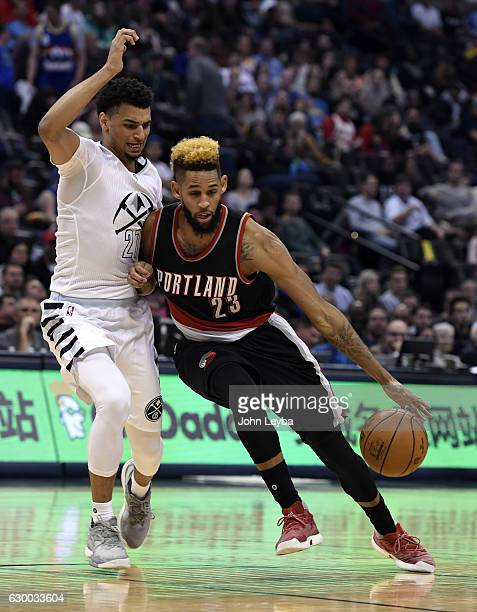 Portland Trail Blazers guard Allen Crabbe drives on Denver Nuggets guard Jamal Murray during the third quarter December 15 2016 at Pepsi Center