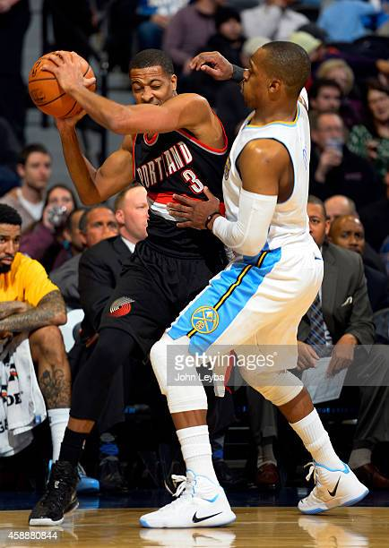 Portland Trail Blazers guard CJ McCollum gets trapped in the corner by Denver Nuggets guard Randy Foye November 12 2014 at Pepsi Center The Blazers...