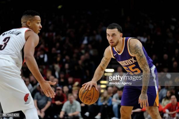 Portland Trail Blazers guard CJ McCollum looks to block a move by the Phoenix Suns in Portland Ore United States on October 2 2017