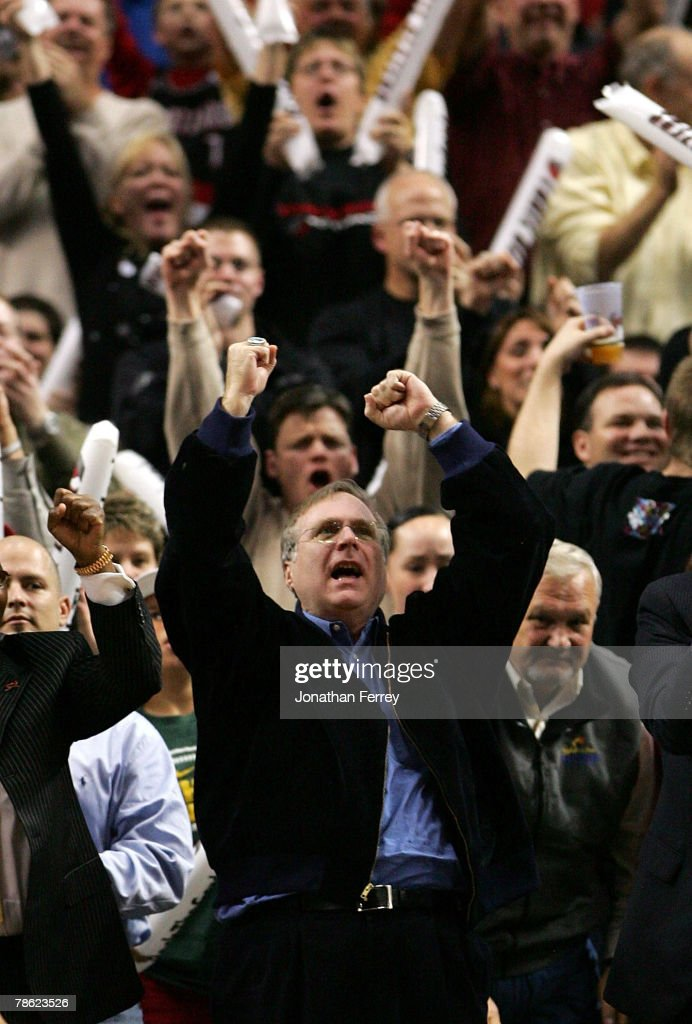 Portland Trail Blazers owner Paul Allen celebrates his team's 10th consecutive victory during the game against the Denver Nuggets at the Rose Garden...