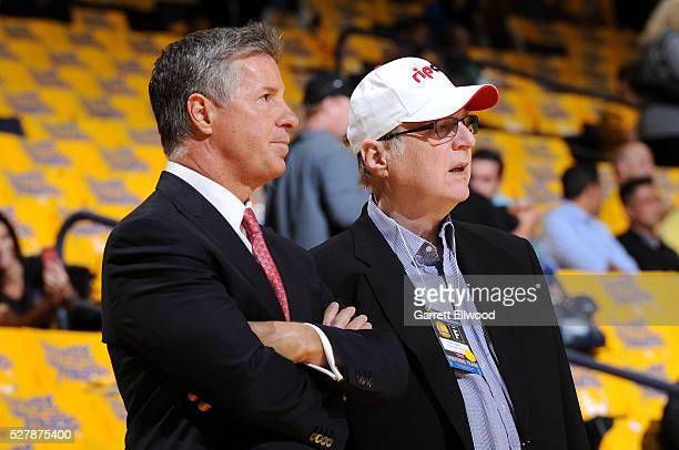 Portland Trail Blazers owner Paul Allen talks with general manager Neil Olshey before the game between the Portland Trail Blazers and the Golden...