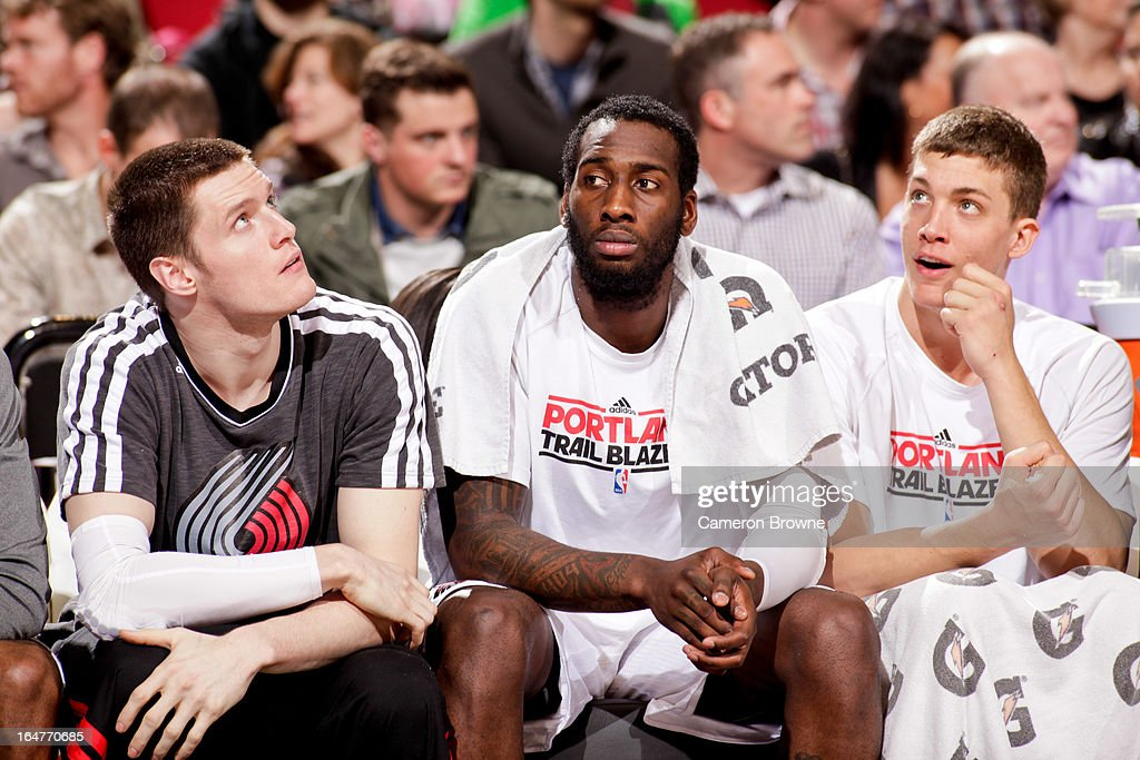 Portland Trail Blazers players, from left, <a gi-track='captionPersonalityLinkClicked' href=/galleries/search?phrase=Luke+Babbitt&family=editorial&specificpeople=5122155 ng-click='$event.stopPropagation()'>Luke Babbitt</a> #8, <a gi-track='captionPersonalityLinkClicked' href=/galleries/search?phrase=J.J.+Hickson&family=editorial&specificpeople=4226173 ng-click='$event.stopPropagation()'>J.J. Hickson</a> #21 and <a gi-track='captionPersonalityLinkClicked' href=/galleries/search?phrase=Meyers+Leonard&family=editorial&specificpeople=6893999 ng-click='$event.stopPropagation()'>Meyers Leonard</a> #11 look on from the bench during a game against the Memphis Grizzlies on March 12, 2013 at the Rose Garden Arena in Portland, Oregon.