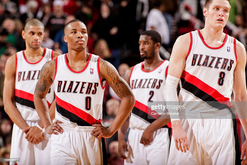 Portland Trail Blazers players, from left, Nicolas Batum #88, Damian Lillard #0, Wesley Matthews #2 and Luke Babbitt #8 wait to resume play against the Milwaukee Bucks on January 19, 2013 at the Rose Garden Arena in Portland, Oregon.