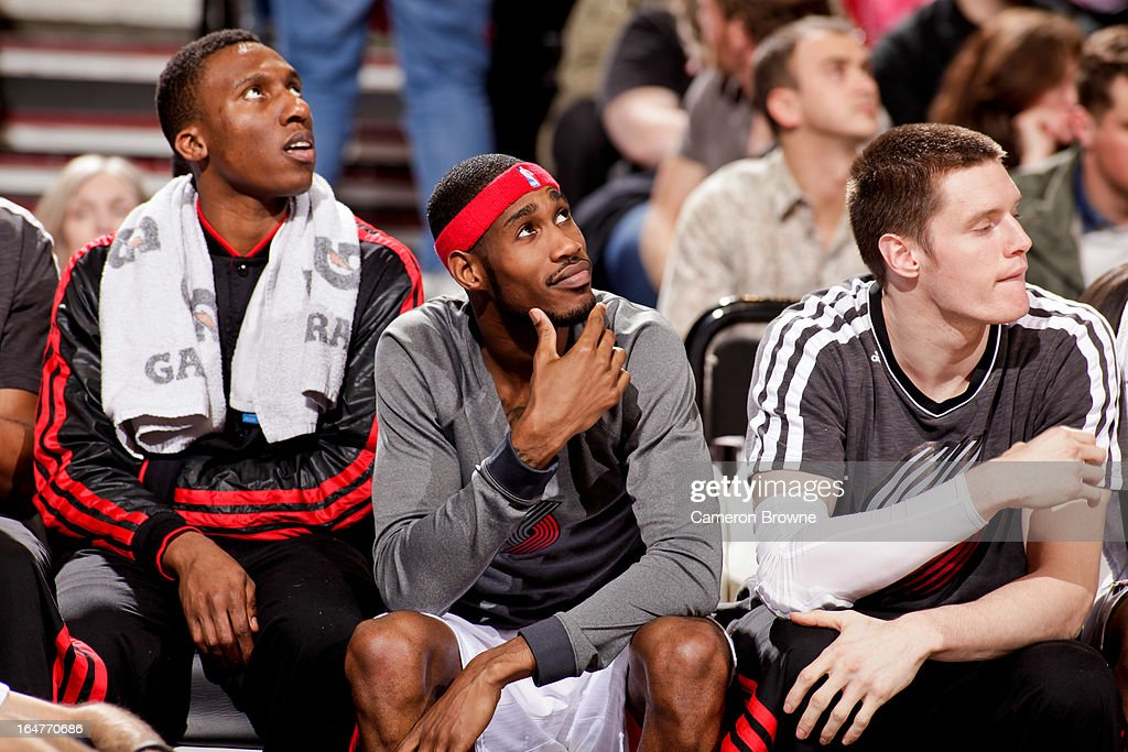 Portland Trail Blazers players, from left, <a gi-track='captionPersonalityLinkClicked' href=/galleries/search?phrase=Nolan+Smith&family=editorial&specificpeople=4215916 ng-click='$event.stopPropagation()'>Nolan Smith</a> #4, <a gi-track='captionPersonalityLinkClicked' href=/galleries/search?phrase=Will+Barton&family=editorial&specificpeople=6894020 ng-click='$event.stopPropagation()'>Will Barton</a> #5 and <a gi-track='captionPersonalityLinkClicked' href=/galleries/search?phrase=Luke+Babbitt&family=editorial&specificpeople=5122155 ng-click='$event.stopPropagation()'>Luke Babbitt</a> #8 look on from the bench during a game against the Memphis Grizzlies on March 12, 2013 at the Rose Garden Arena in Portland, Oregon.