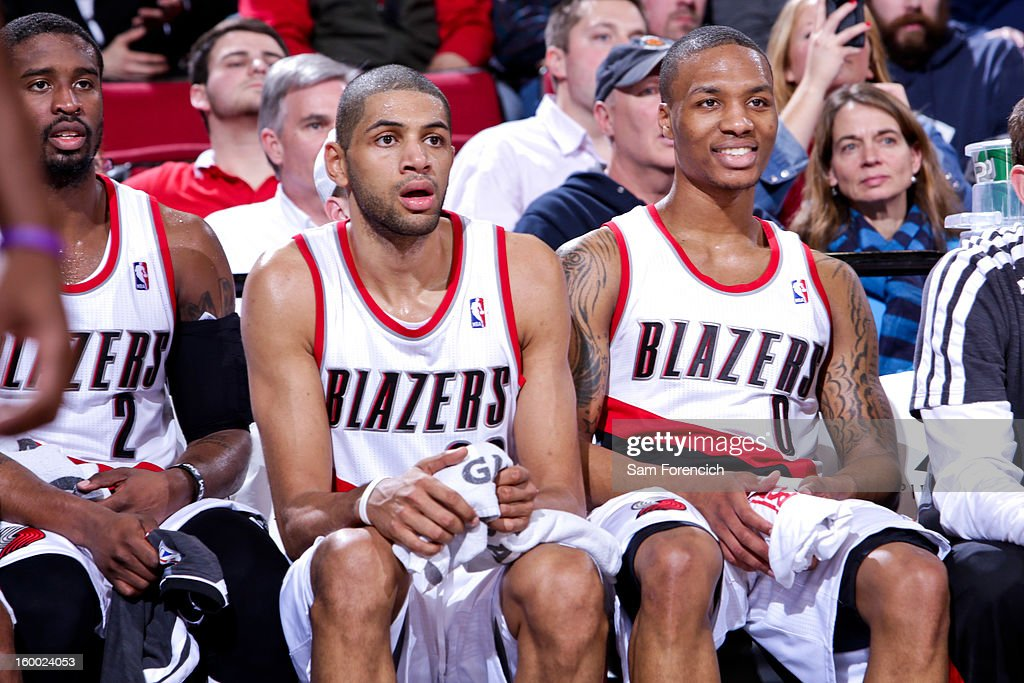 Portland Trail Blazers players, from left, Wesley Matthews #2, Nicolas Batum #88 and Damian Lillard #0 look on from the bench during a game against the Indiana Pacers on January 23, 2013 at the Rose Garden Arena in Portland, Oregon.