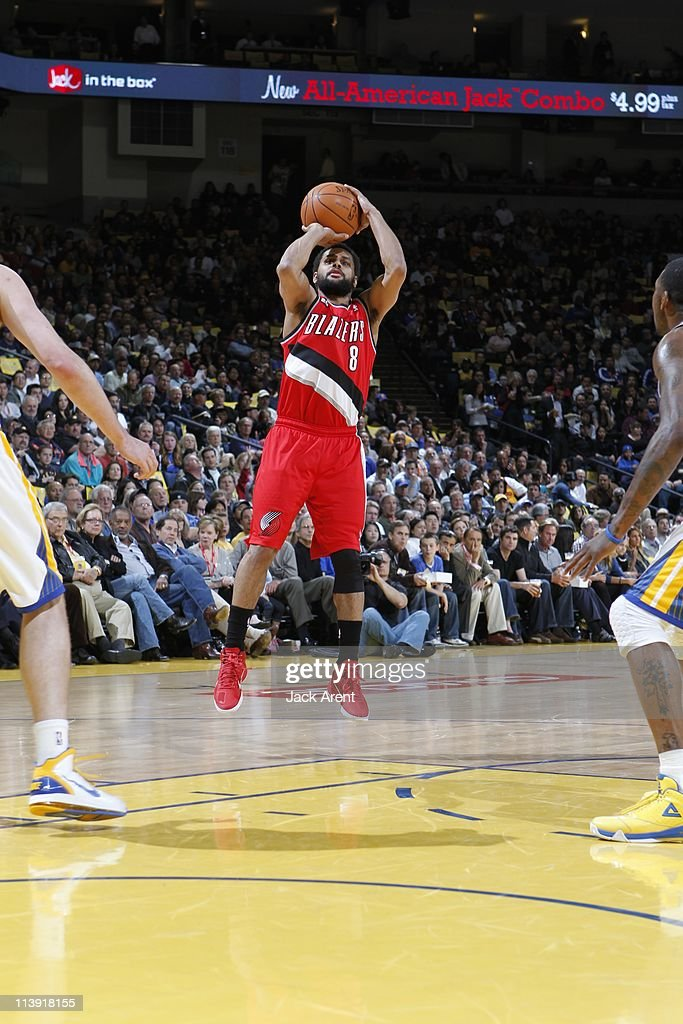 Portland Trail Blazers point guard <a gi-track='captionPersonalityLinkClicked' href=/galleries/search?phrase=Patrick+Mills&family=editorial&specificpeople=550011 ng-click='$event.stopPropagation()'>Patrick Mills</a> #8 goes for a jump shot during the game against the Golden State Warriors on April 13, 2011 at Oracle Arena in Oakland, California. The Warriors won 110-86.