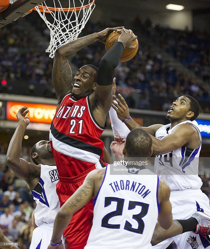 Portland Trail Blazers power forward JJ Hickson grabs rebound from Sacramento Kings center Jason Thompson and Sacramento Kings point guard Tyreke...