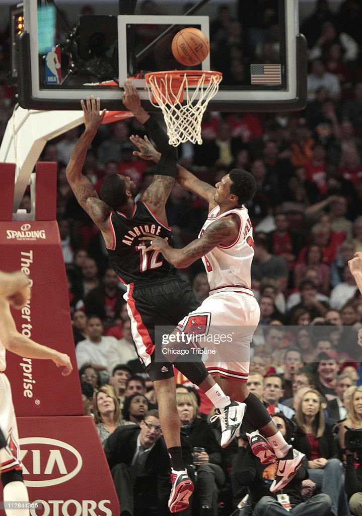 Portland Trail Blazers power forward LaMarcus Aldridge goes to the basket against Chicago Bulls small forward James Johnson during the second quarter...
