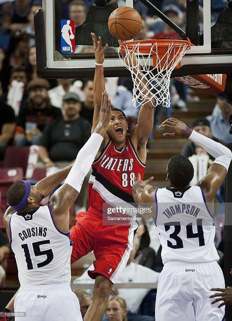 Portland Trail Blazers small forward Nicolas Batum scores basket over Sacramento Kings power forward DeMarcus Cousins and Sacramento Kings center...