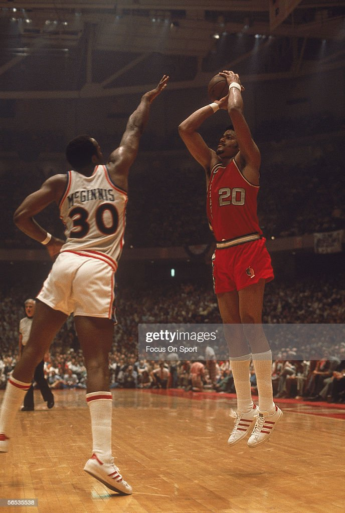 Portland Trailblazers Maurice Lucas shoots a jumpshot against the George McGinnis of the Philadelphia 76ers circa May of 1977 during the NBA playoffs