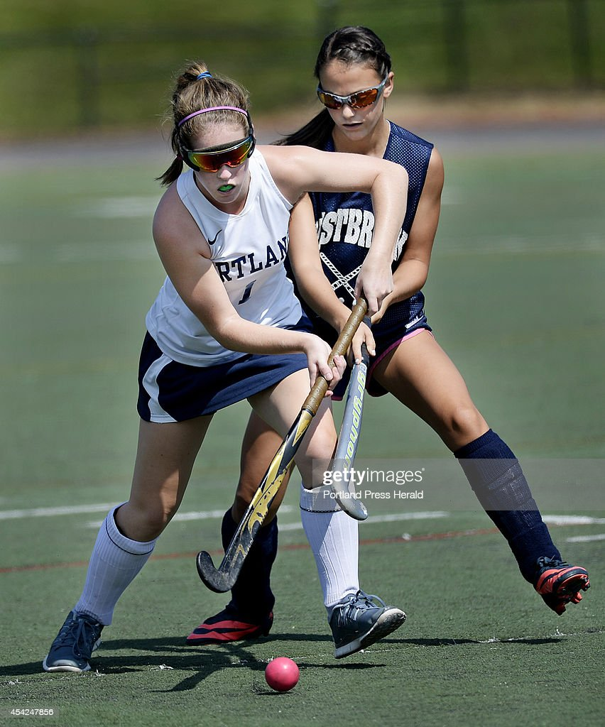 Portland's Georgia Drew battles for the ball with Westbrook's Abby St Clair during the SMMA field hockey play day in Portland Tuesday August 26, 2014.