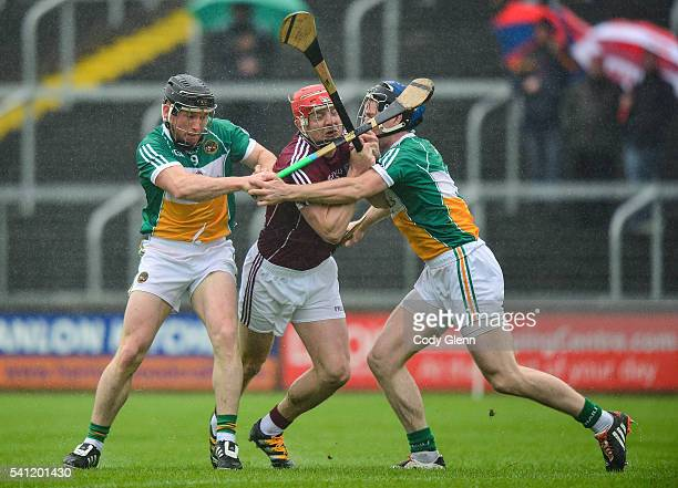 Portlaoise Ireland 19 June 2016 Joe Canning of Galway ìn action against Sean Ryan left and Chris McDonald of Offaly during the Leinster GAA Hurling...